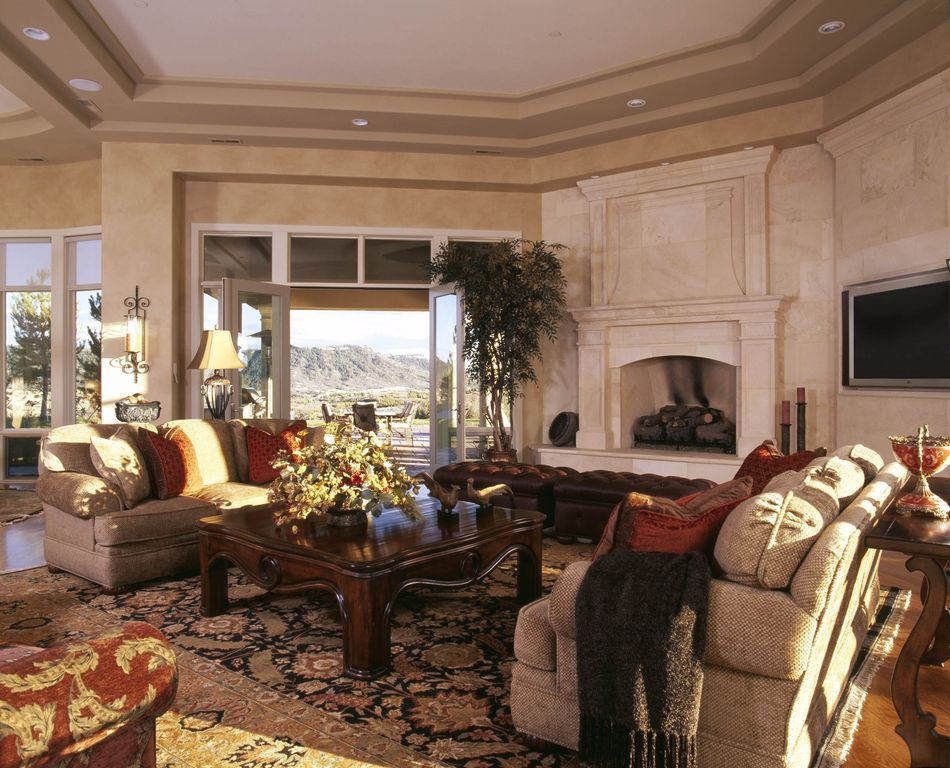 Traditional Living Room with Standard height, Hardwood floors, can lights, Fireplace, Wall sconce, French doors