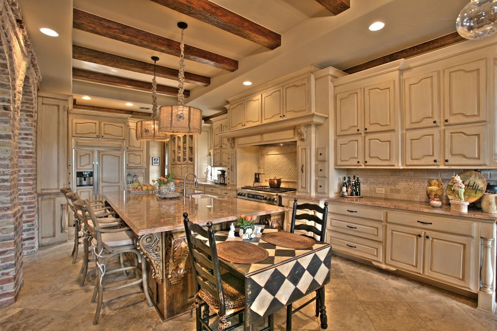 Country Kitchen with High ceiling, L-shaped, Framed Partial Panel, Stone Tile, Built In Panel Ready Refrigerator, can lights