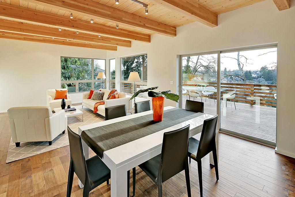 Contemporary Great Room with sliding glass door, specialty window, Hardwood floors, flush light, Exposed beam