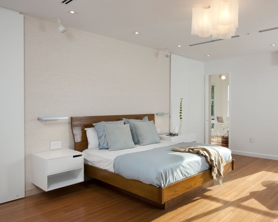 Contemporary Master Bedroom with Laminate floors, can lights, bedroom reading light, Standard height, Built-in bookshelf