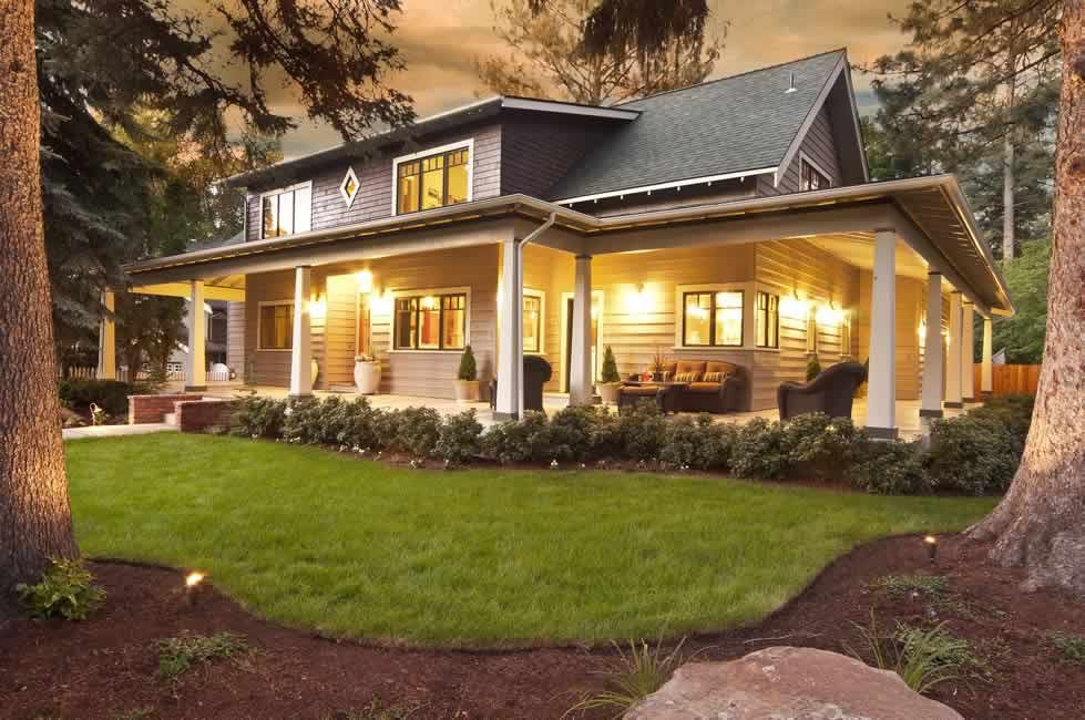 Craftsman Porch with Wrap around porch, French doors, specialty window, Casement, Pathway, exterior stone floors, Fence