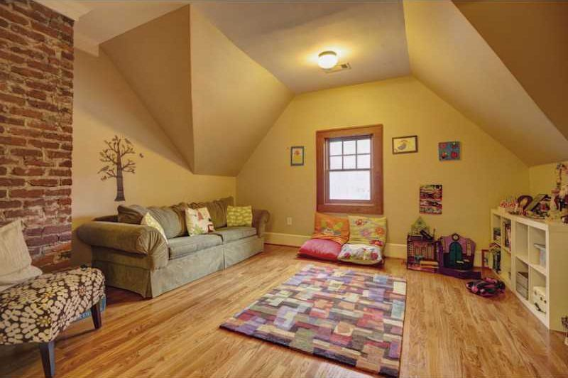 Craftsman Playroom with flush light, Built-in bookshelf, Hardwood floors, interior brick, Standard height, double-hung window