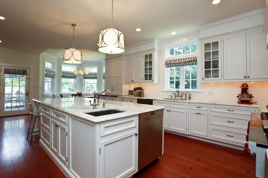 Contemporary Kitchen with Pendant light, single dishwasher, French doors, Breakfast bar, Complex marble counters, L-shaped