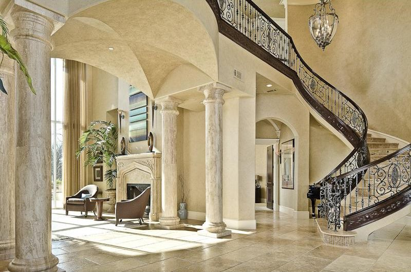 mediterranean staircase with chandelier high ceiling simple granite