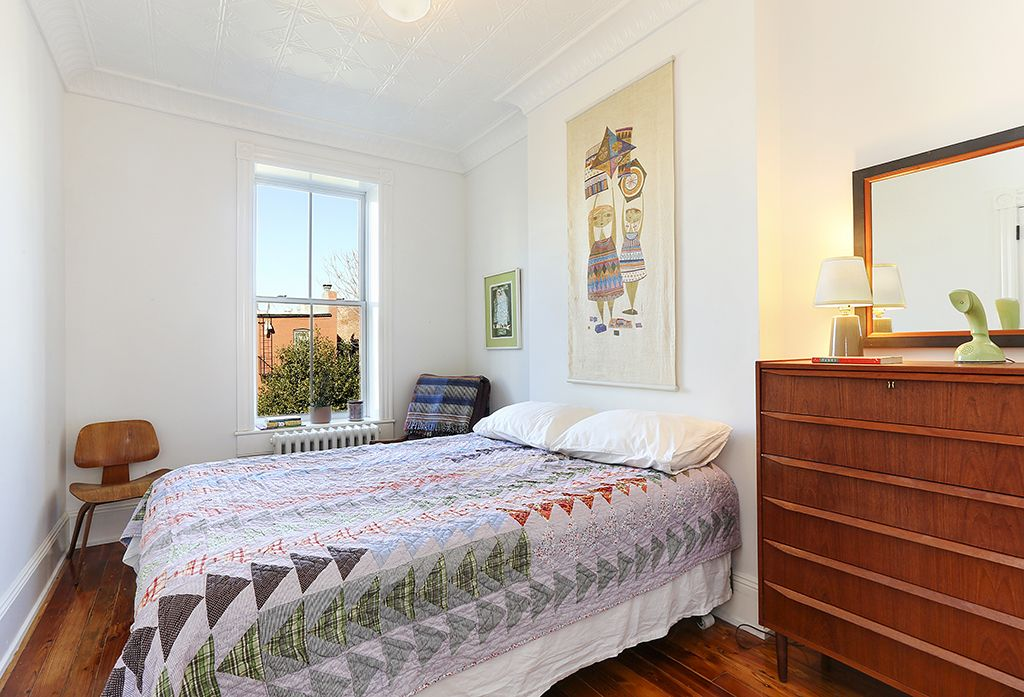 Eclectic Guest Bedroom with flush light, Crown molding, Hardwood floors