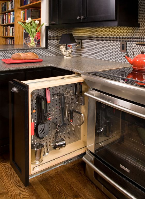 Contemporary Kitchen with Base cabinet pullout with stainless pegboard insert