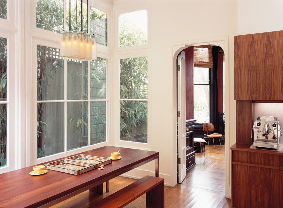 Contemporary Dining Room with double-hung window, specialty window, Laminate floors, High ceiling, Pendant light