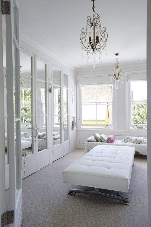 Traditional Closet with Crown molding, Casement, Carpet, Chandelier, Standard height, French doors
