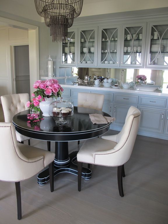 Traditional Dining Room with Wilsonart - Coconut Oil, Laminate floors, Built-in bookshelf, Paint 2, Paint 1, Standard height