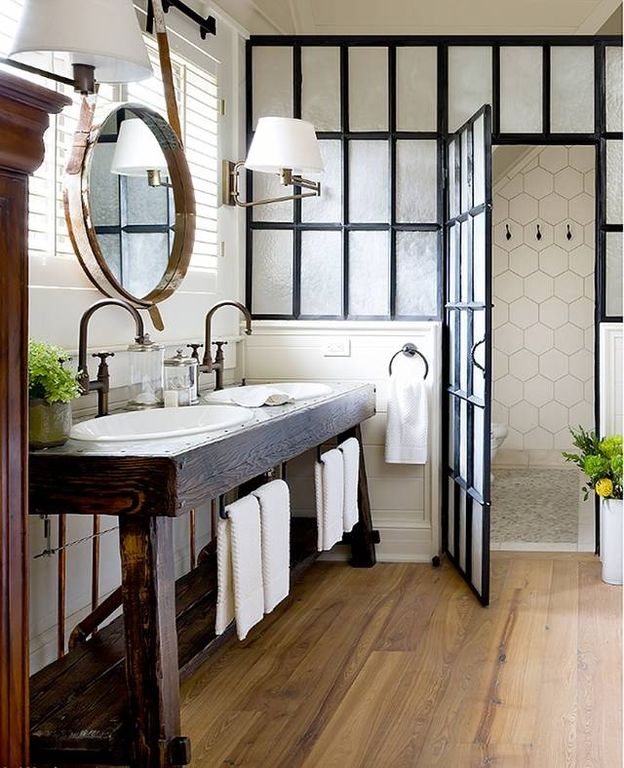 Rustic Master Bathroom with Hardwood floors, Stainless steel counters, Crown molding, specialty door, Swing arm wall sconce