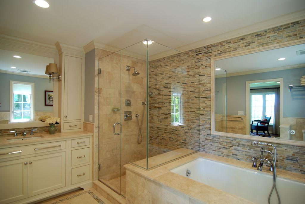 Traditional Master Bathroom with stone tile floors, can lights, Bathtub, Handheld showerhead, Crown molding, Standard height