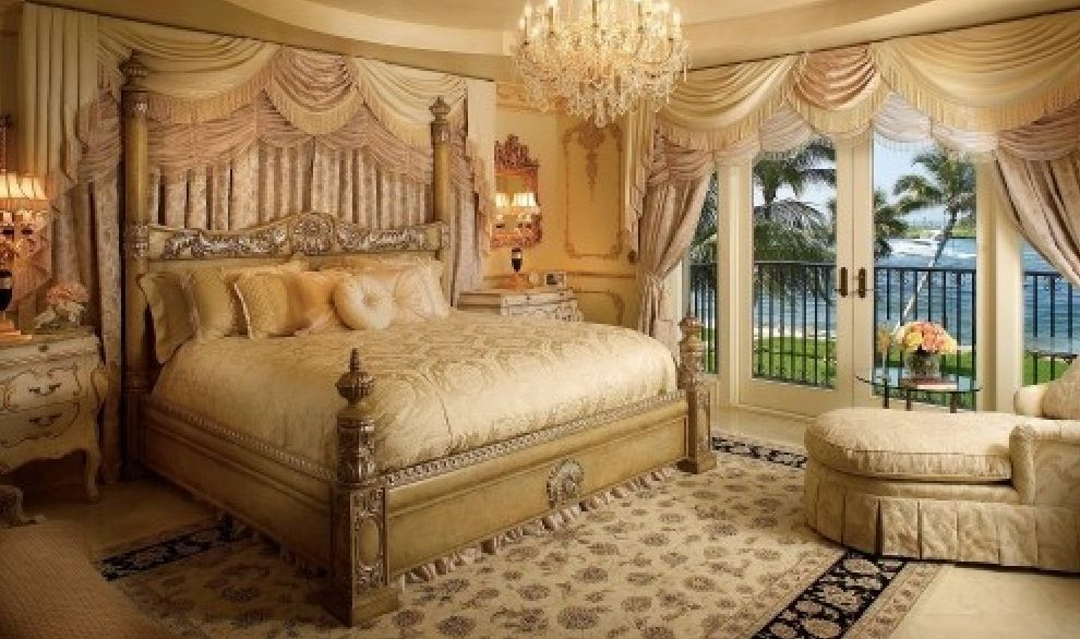 Traditional Master Bedroom with French doors, Wall sconce, Standard height, Chandelier, Carpet