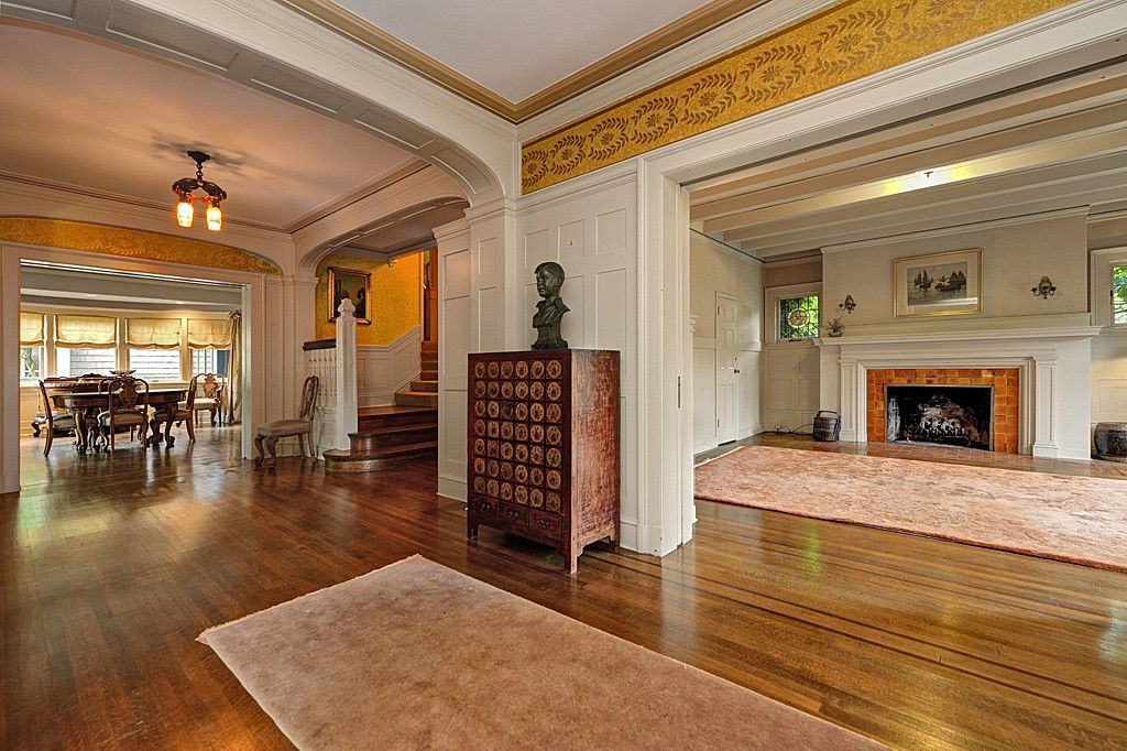 Traditional Entryway with Standard height, interior wallpaper, Hardwood floors, Crown molding
