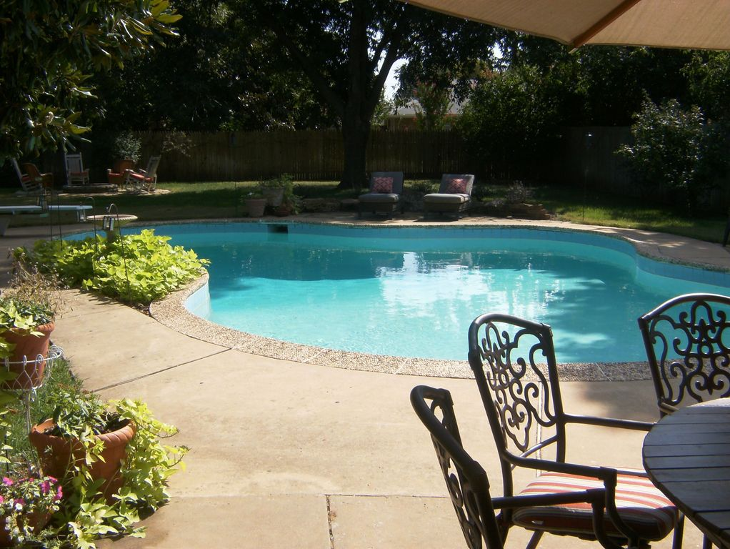 Traditional Swimming Pool with Fence, exterior tile floors, Raised beds, exterior concrete tile floors, Other Pool Type