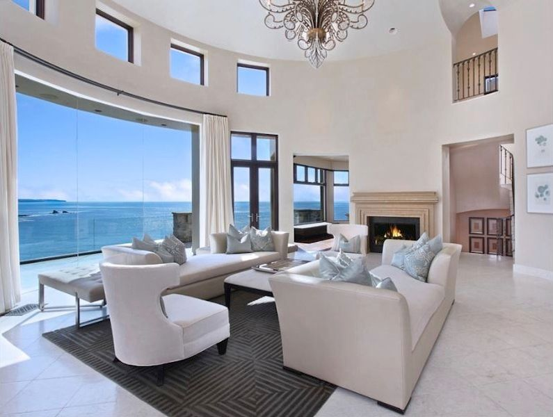 Contemporary Living Room with French doors, picture window, Chandelier, Transom window, Loft, specialty window, Fireplace