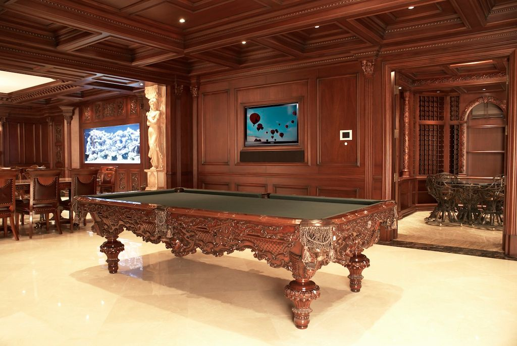 Traditional Game Room with can lights, Chair rail, Crown molding, sandstone tile floors, Standard height, stone tile floors