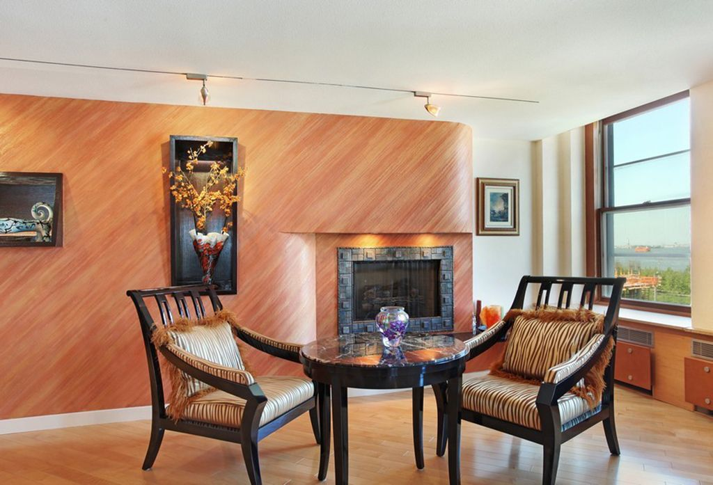 Contemporary Living Room with Standard height, Fireplace, stone fireplace, Laminate floors, Window seat, flush light