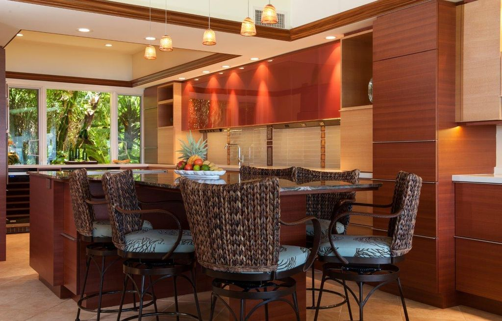 Tropical Kitchen with Breakfast nook, Casement, can lights, Complex marble counters, Kitchen island, full backsplash, Flush