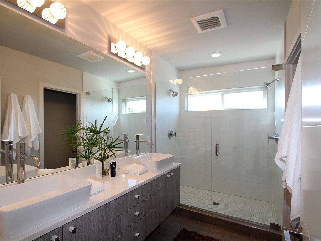 Contemporary Master Bathroom with European Cabinets, Flush, stone tile floors, wall-mounted above mirror bathroom light