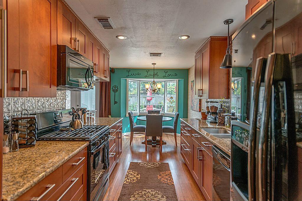 Contemporary Kitchen with full backsplash, dishwasher, double oven range, Hardwood floors, Standard height, Multiple Sinks