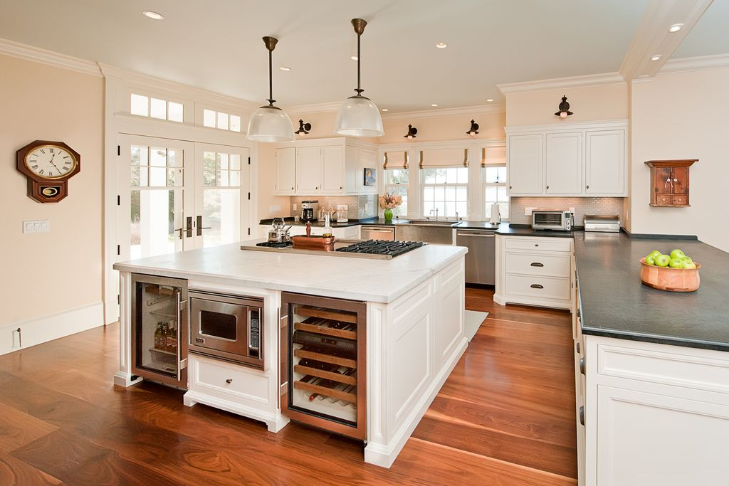 Traditional Kitchen with Transom window, electric cooktop, Standard height, dishwasher, Farmhouse sink, French doors