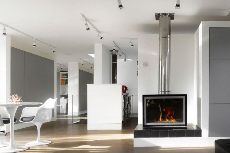 Contemporary Dining Room with can lights, Laminate floors, Standard height, Built-in bookshelf, Fireplace, metal fireplace