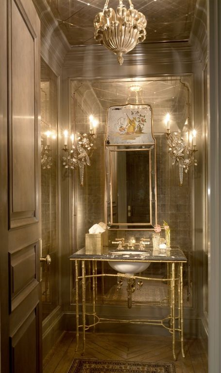 Traditional Powder Room with Crown molding, herringbone tile floors, Standard height, Powder room, Chandelier, Wall sconce