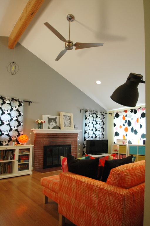 Eclectic Living Room with brick fireplace, Fireplace, Hardwood floors, can lights, Ceiling fan, Exposed beam, Standard height
