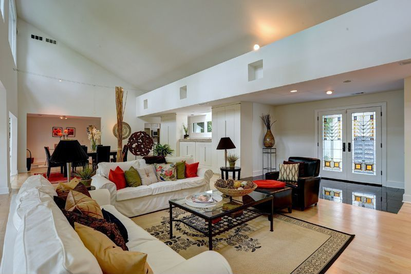 Contemporary Great Room with High ceiling, Built-in bookshelf, can lights, French doors, flush light, picture window