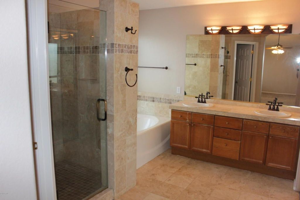 Traditional Master Bathroom with Limestone Tile, European Cabinets, Double sink, stone tile counters, Wall Tiles, Bathtub