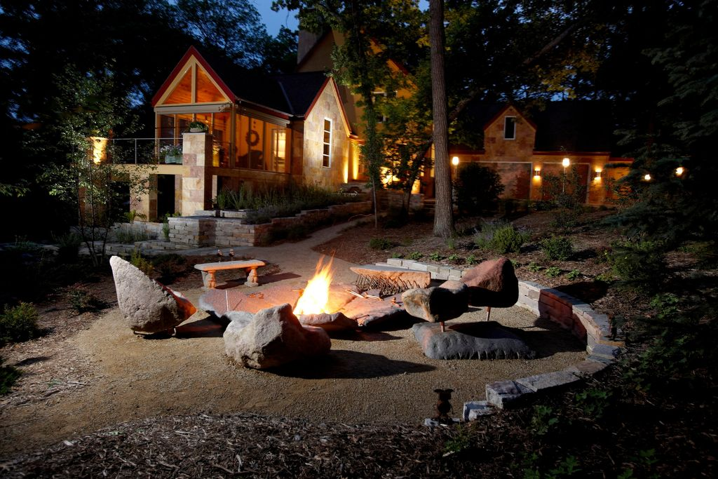 Rustic Landscape/Yard with Raised beds, Deck Railing, exterior stone floors, picture window, Pathway, Stone seating, Fire pit