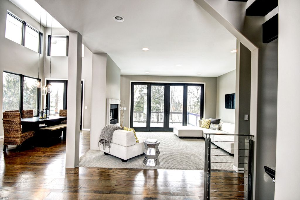 Contemporary Great Room with picture window, French doors, insert fireplace, Pendant light, Hardwood floors, specialty window