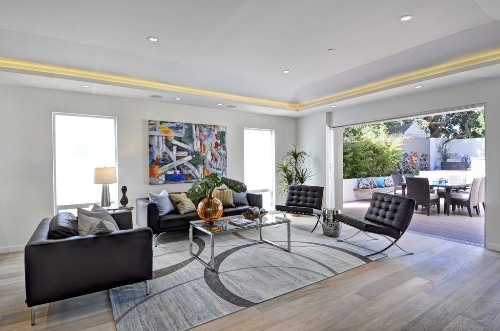 Contemporary Living Room with double-hung window, Standard height, can lights, Hardwood floors