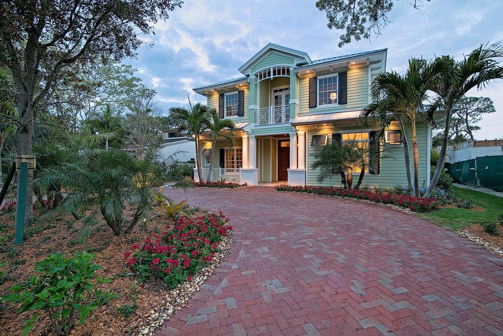 Tropical Exterior of Home with Accent exterior architectural lighting