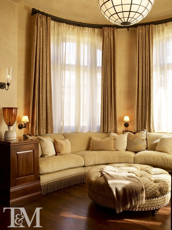 Contemporary Living Room with Hardwood floors, bedroom reading light, Wall sconce, flush light, Arched window