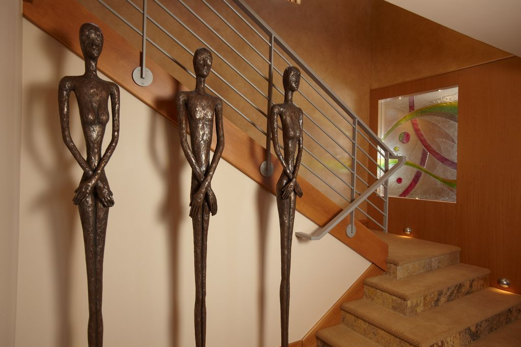 Contemporary Staircase with Art glass, Paint 2, Paint 1, High ceiling, Carpet, Large scale artwork, curved staircase