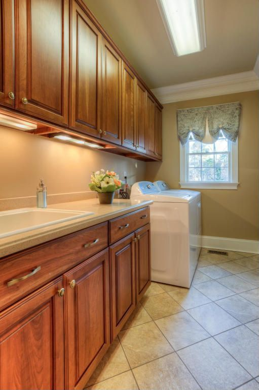 Traditional Laundry Room with flush light, Built-in bookshelf, double-hung window, laundry sink, drop-in sink, Crown molding