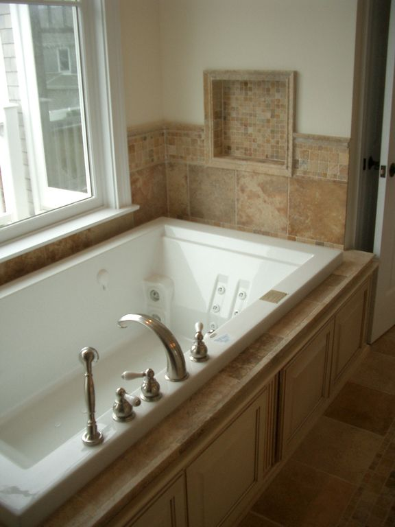 "Traditional Master Bathroom with stone tile floors, Bathtub, Casement, Standard height, 12"" x 12"" porcelain tile, Paint"