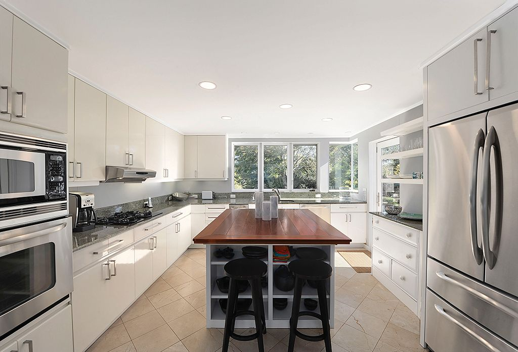 Contemporary Kitchen with partial backsplash, built-in microwave, Kitchen island, wall oven, Simple Granite, Casement