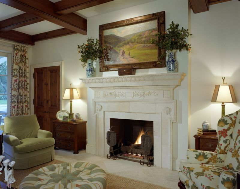 Traditional Living Room with Cement fireplace, Standard height, specialty door, limestone floors, Fireplace, Exposed beam