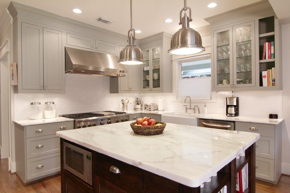 Traditional Kitchen with Complex marble counters, L-shaped, dishwasher, Glass panel, gas range, Crown molding, Kitchen island