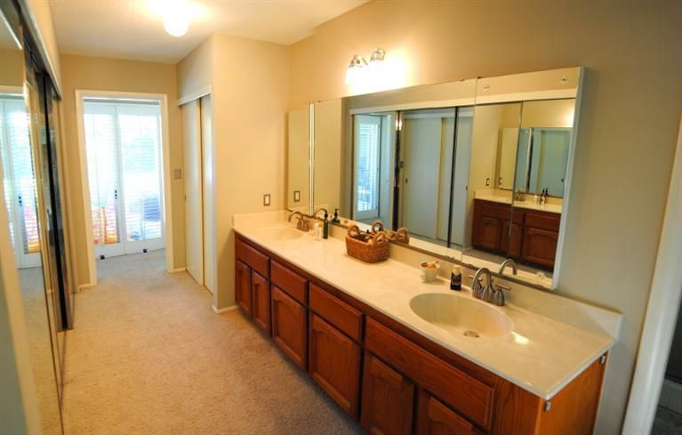Traditional Master Bathroom with Double sink, Limestone, Flat panel cabinets, Raised panel, Standard height, flush light