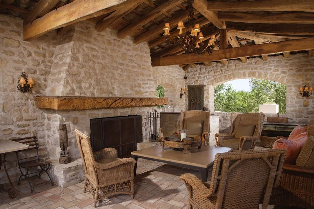 Mediterranean Patio with Wrap around porch, exterior tile floors, exterior interlocking pavers