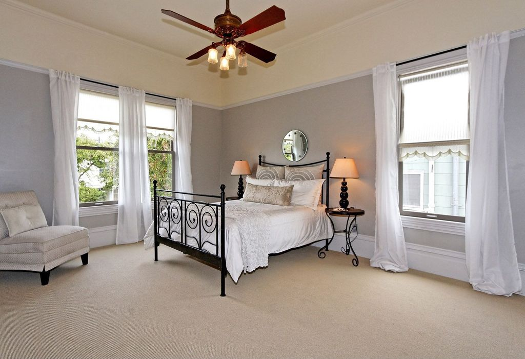 Traditional Guest Bedroom with Crown molding, High ceiling, Kingston - mahogany gold queen metal bed, Ceiling fan, Carpet