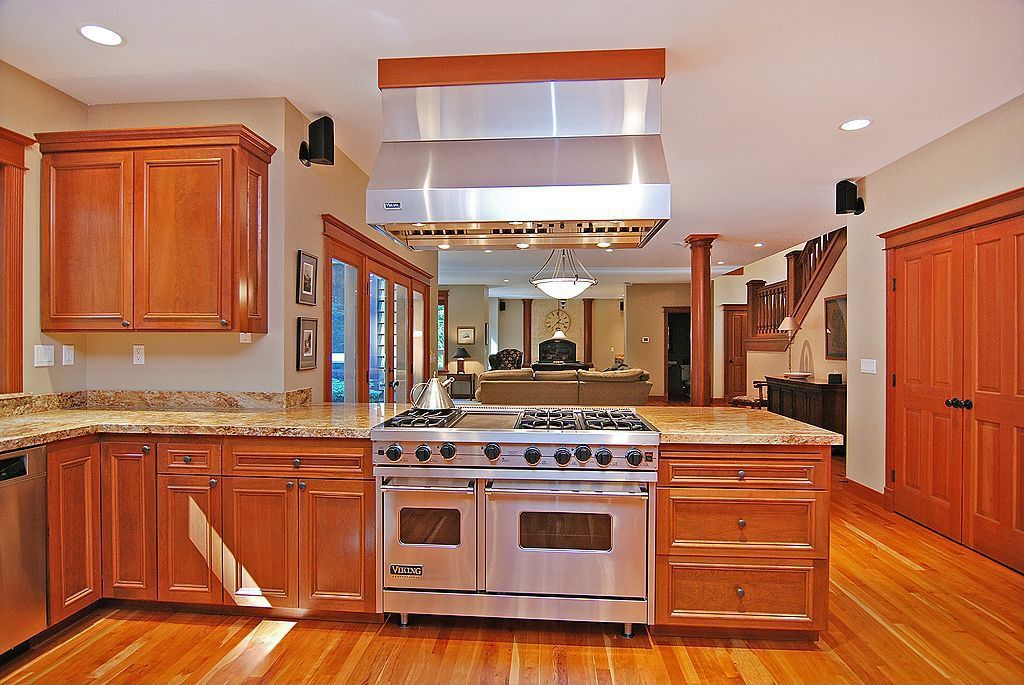 Traditional Kitchen with Flat panel cabinets, Armstrong Flooring - Cherry in Natural, Complex Granite, Laminate floors, Onyx