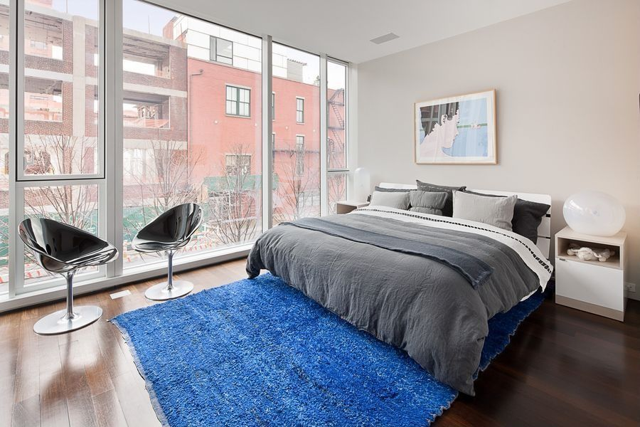 Contemporary Guest Bedroom with Standard height, picture window, specialty window, Hardwood floors