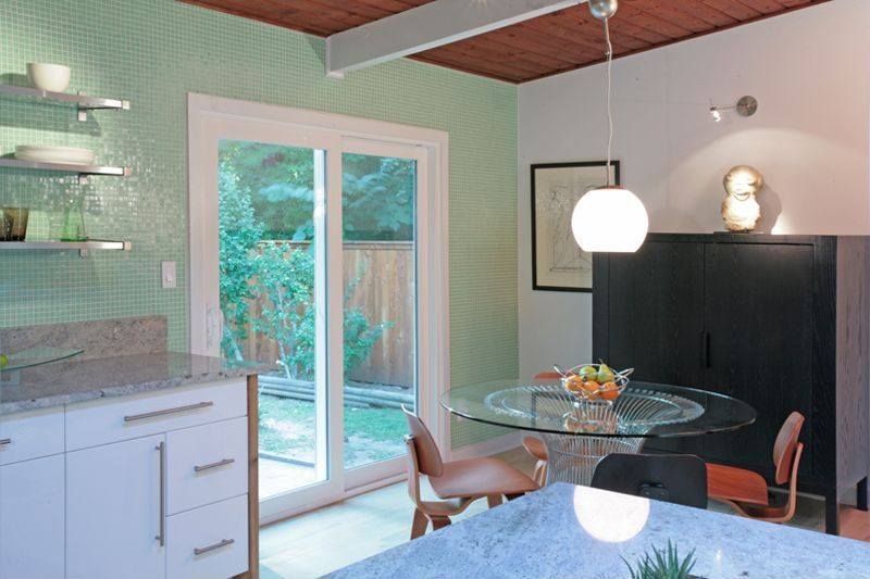 Contemporary Dining Room with Standard height, Wall sconce, Concrete floors, sliding glass door, interior wallpaper