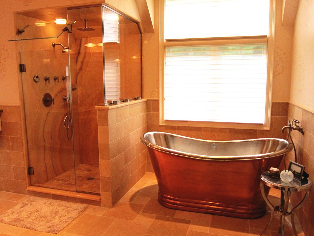 Rustic Master Bathroom with Casement, Paint 1, Freestanding, flush light, Copper tub, Wall Tiles, Handheld showerhead, Shower