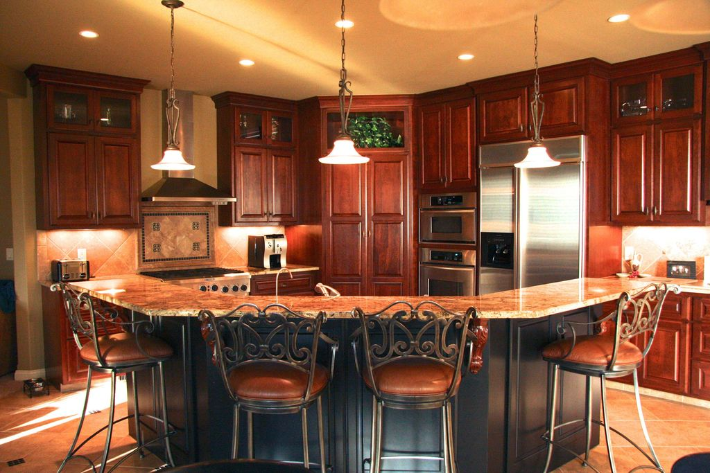 Traditional Kitchen with Inset cabinets, Raised panel, L-shaped, Stone Tile, Wall Hood, Glass panel, double wall oven