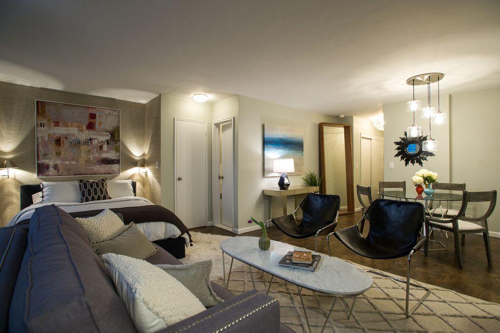 Contemporary Living Room with Hardwood floors, Midcentury modern, Sofa, Pendant light, Standard height, Flush mount light